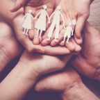 adult-children-hands-holding-paper-family-cutout-family-home_49149-814