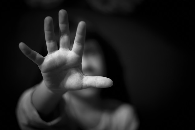 girl-s-hand-dark_127220-3