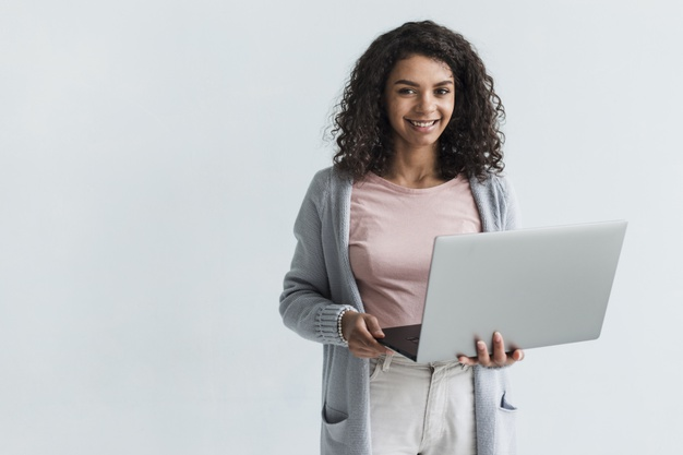 smiling-ethnic-woman-with-gray-laptop_23-2148180696